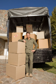 Man standing by moving truck